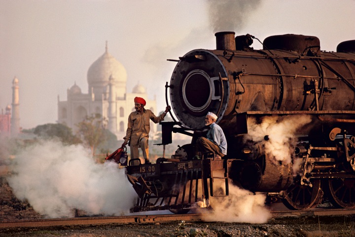Workers move a steam locomotive at the railway yard in Agra, near Taj Mahal, Pradesh, India, 1983